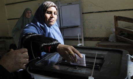 Egyptians voted in the December 22, 2012 referendum on a draft constitution. The vote won by 64% in favor but only 30% participated. by Pan-African News Wire File Photos