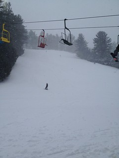 A snowboarder glides down fresh powder at Lost Valley in Auburn.
