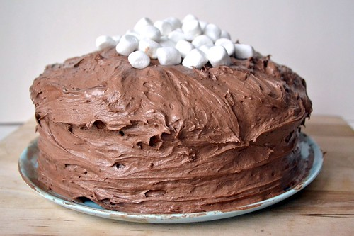 hot chocolate filled cake with hot chocolate frosting and marshmallows