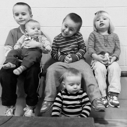 CouSins at the 10 am toilet bowl b Bball game .  Cute kids watching their uncle.