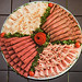 Any combination of premium deli-sliced meats: roast beef, ham, corned beef, turkey ... the possibilities are endless. Ask about other assortments.  12 Inch (Serves 10 - 14)$25.99 16 Inch (Serves 16 - 20)$38.99 18 Inch (Serves 24 - 30)$51.99