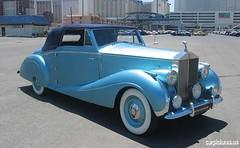 packard super eight(0.0), packard 120(0.0), touring car(0.0), automobile(1.0), rolls-royce phantom iii(1.0), vehicle(1.0), rolls-royce silver dawn(1.0), antique car(1.0), sedan(1.0), vintage car(1.0), land vehicle(1.0), luxury vehicle(1.0), convertible(1.0),
