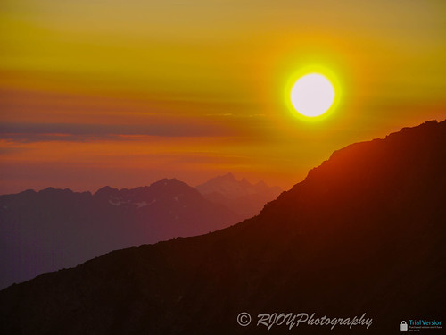 sunset red orange sun mountain snow mountains clouds landscape peak frosty panasonic summit manningpark rjoyphotography