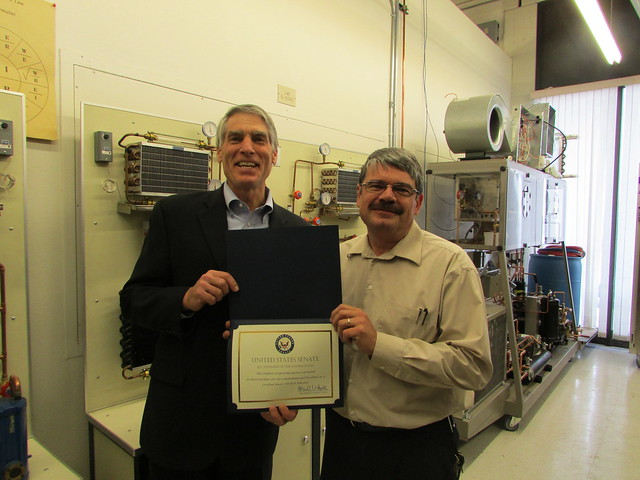 Mark Udall presents a certificate to Dan Crawshaw to recognize his commitment and excellence as a certified Master HVACR educator.