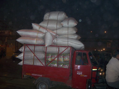 Overloaded rations delivery service at the Kumbh Mela