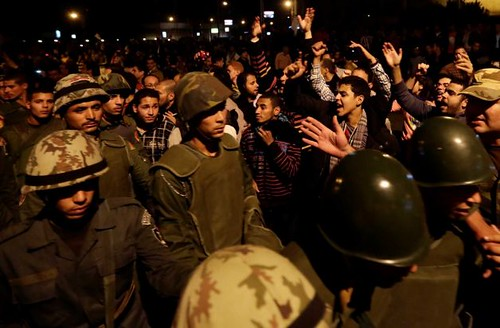 An Egyptian military column walks through crowd during mass demonstration in Cairo on December 7, 2012. The military says that there should be dialogue to resolve the poltical crisis. by Pan-African News Wire File Photos