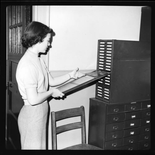 Miss Shirley Robbins looks through a Kardex, January 8, 1952
