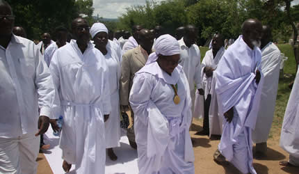 Vice President Joice Mujuru accompanied by the Gospel of God Church secretary general Zaburon Nengomasha (right) arrive at the Gandanzara Shrine, Rusape, on December 16, 2012. The Vice President addressed the government policy of indigenization. by Pan-African News Wire File Photos
