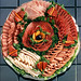 A savory variety of fresh-sliced Ham, Summer Sausage, bologna, turkey, cotto salami and hard salami. A masterfully prepared platter that's sure to please even the most discriminating palettes.