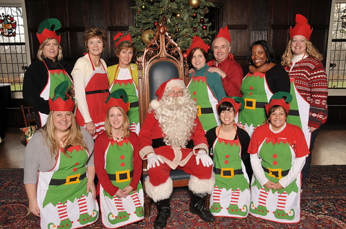 Santa and his elves in the Mansion at Christmas at Cabrini