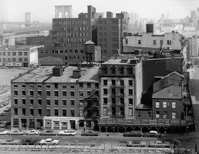 By the late 1960s, vast swaths of Lower Manhattan were gritty, abandoned relics of 19th century industry and housing. Looking to the Brooklyn Bridge from Gold Street in the foreground and Beekman Street at right. New York. 1967