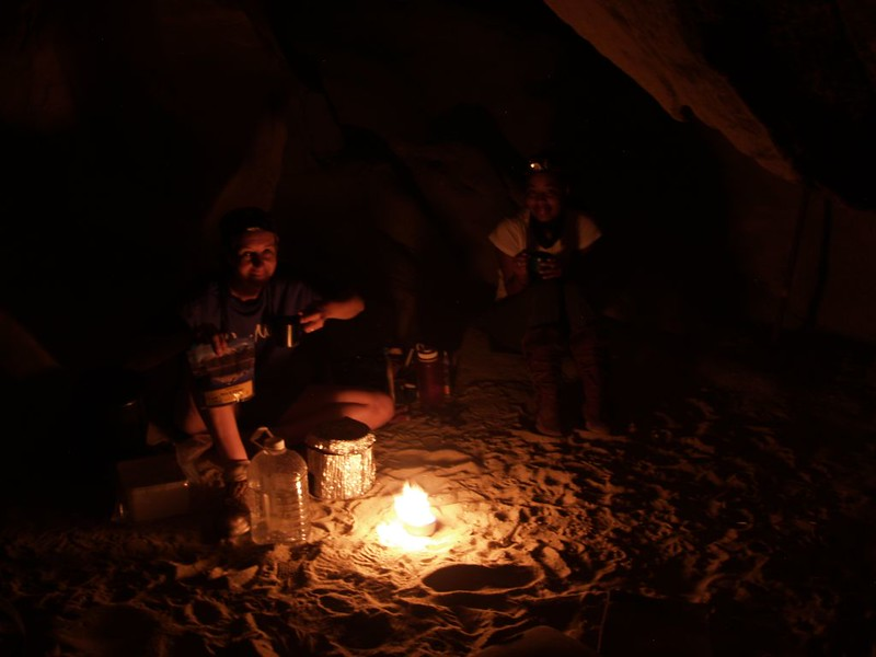 Cooking dinner by the light of our buddy burner inside one of the Wind Caves