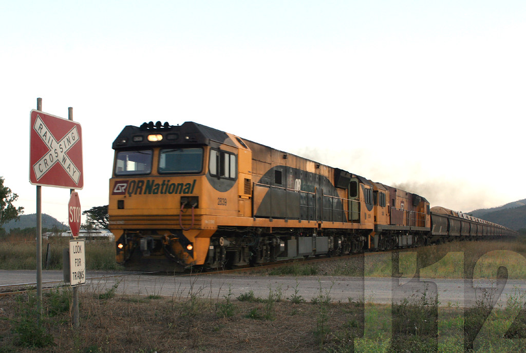 QR National 2839 / 2826 hauls a load through a level crossing in the Haughton Valley area, as it heads towards Townsville ~27.09.12 by James 460