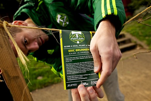 "Timbers' Eric Brunner placing a tag on a tree planted in honor of his goal for Timbers-FOT ""Score a Goal, Plant a Tree"" (Craig Mitchelldyer)"