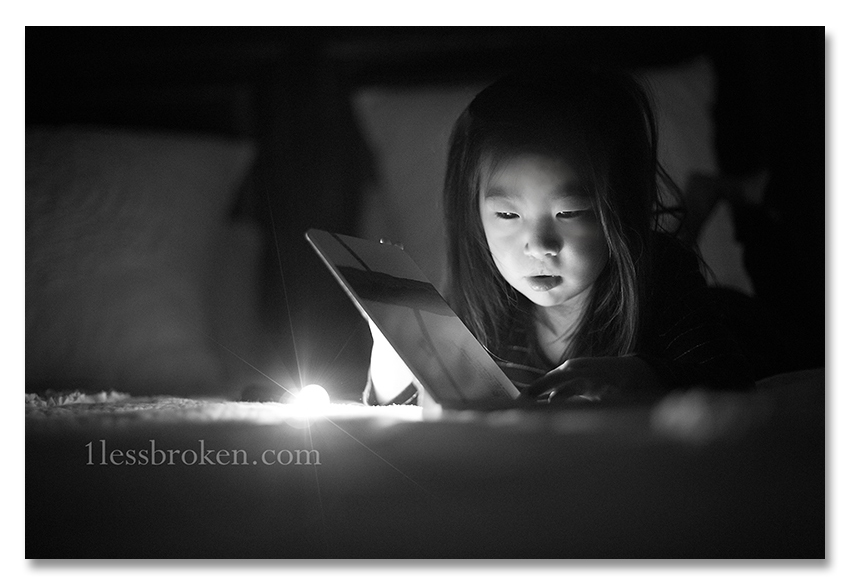 BLOG reading with light on head without flare