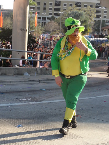 A man walking with the Irish float