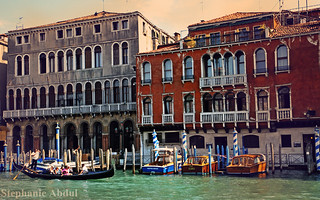 Gondoliers and Architecture Along a Venetian Canal