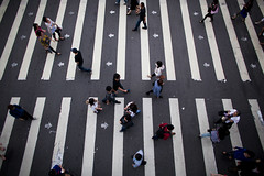 Pedestrians cross a road in the business district of Xinyi in Taipei, Taiwan.