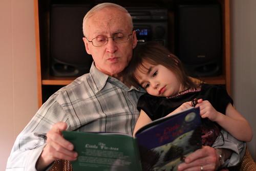 Grandpa reading to Nora