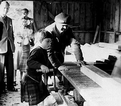 1957 Prince Charles (later The Prince of Wales) operates a circular saw during a visit to a sawmills on the Balmoral Estate, September 1957.