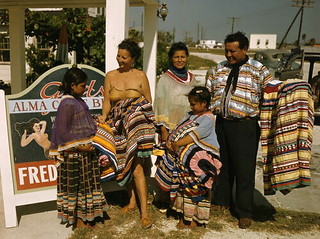 Seminole family selling patchwork clothing near the Brighton Reservation