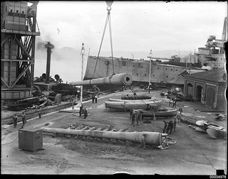 Guns being removed from the former HMAS AUSTRALIA I