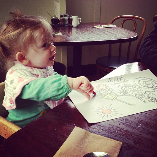 Coloring at breakfast (and sneakily eating crayons when given the chance)