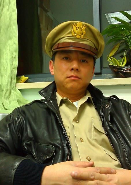 Portrait in WWII Pilot Jacket,Visor Hat & Army Uniforms,1