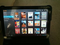 Kindle books on tablet showing the power of Amazon Kindle free books in the book marketing coach category