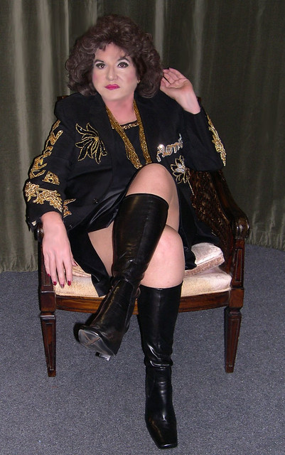 Me, short satin mini skirt, pvc boots.