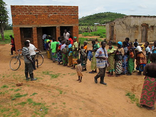 Mothers queue to exchange their vouchers for a kit Yamoyo