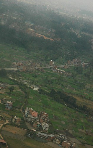 Kathmandu bowl area, fields of houses, apartments, and businesses, landscape, crops, haze, Nepal from above by Wonderlane
