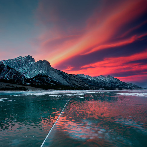 sunset red sky canada reflection ice iso100 nikon magenta bubbles crack alberta nordegg f22 cracks nikkor cracked d800 abrahamlake 14mm