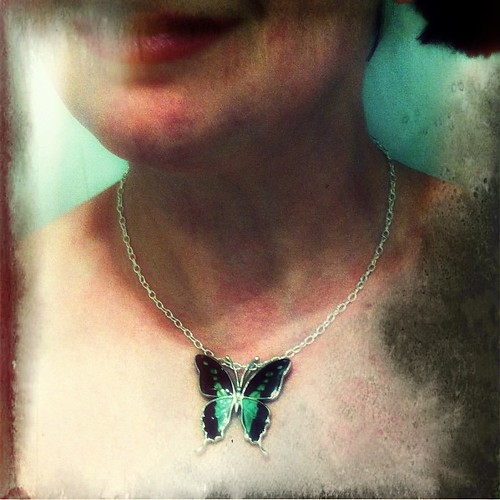 Wearing a butterfly. Dark version. by The Shutterbug Eye™