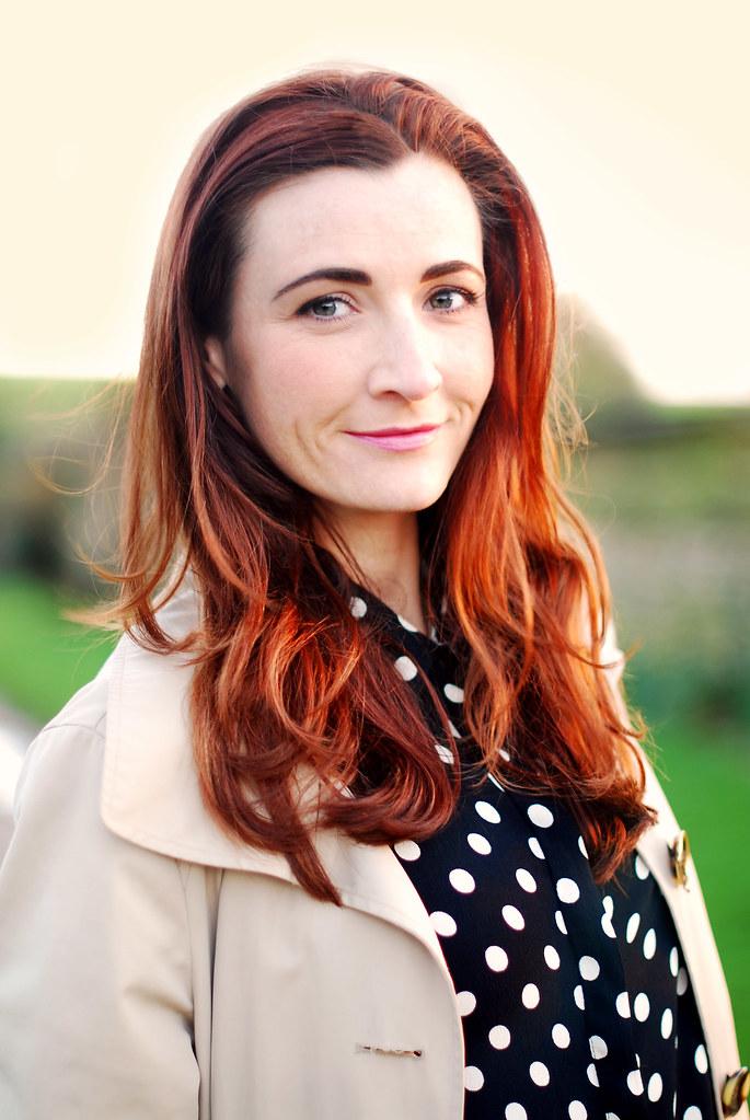 Polka dots, trenchcoat & red hair