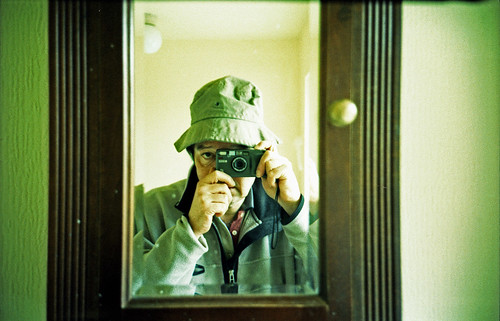reflected self-portrait with Ricoh R1 camera and canvas hat by pho-Tony
