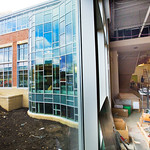 13-01-02 -- JANUARY 2013: A first-floor view of the new classroom building's curved windows facing north toward CLA.
