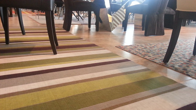 Rugs can bring a little life to a boring room. I'm always scared off by the price.