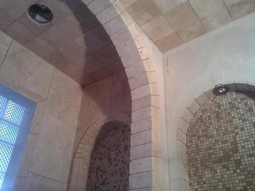 Travertine tile arches & mosaic tile background