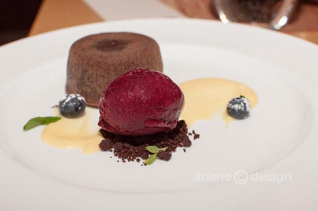 Warm chocolate cake, coffee soil, cassis sorbet