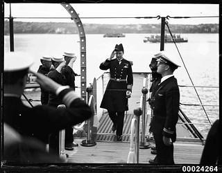 Royal Australian Navy officer boarding USS ASTORIA