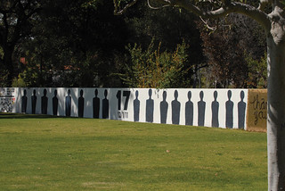 Seventeen silhouettes painted on Walker Wall, Pomona's free-speech wall, representing 17 employees who were fired following a controversial investigation of the College's work authorization practices in December 2011