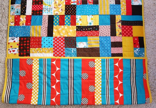 loud baby quilt - showing backing fabric