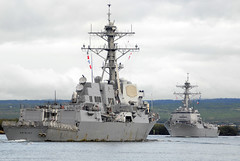 USS Gridley (DDG 101), on the final leg of a six-month deployment to the U.S. 7th and 5th Fleet areas of operation, enters Joint Base Pearl Harbor-Hickam Jan. 28 as the guided-missile destroyer USS Michael Murphy (DDG 112) departs. (U.S. Navy photo by Mass Communication Specialist 2nd Class Jon Dasbach)