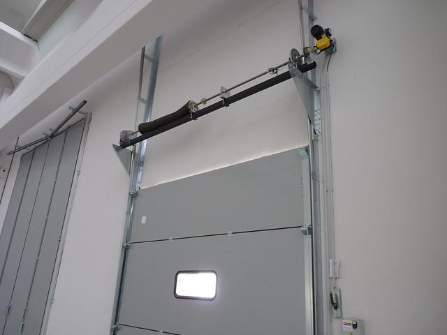 Porta sezionale Overdoor scorrimento VER
