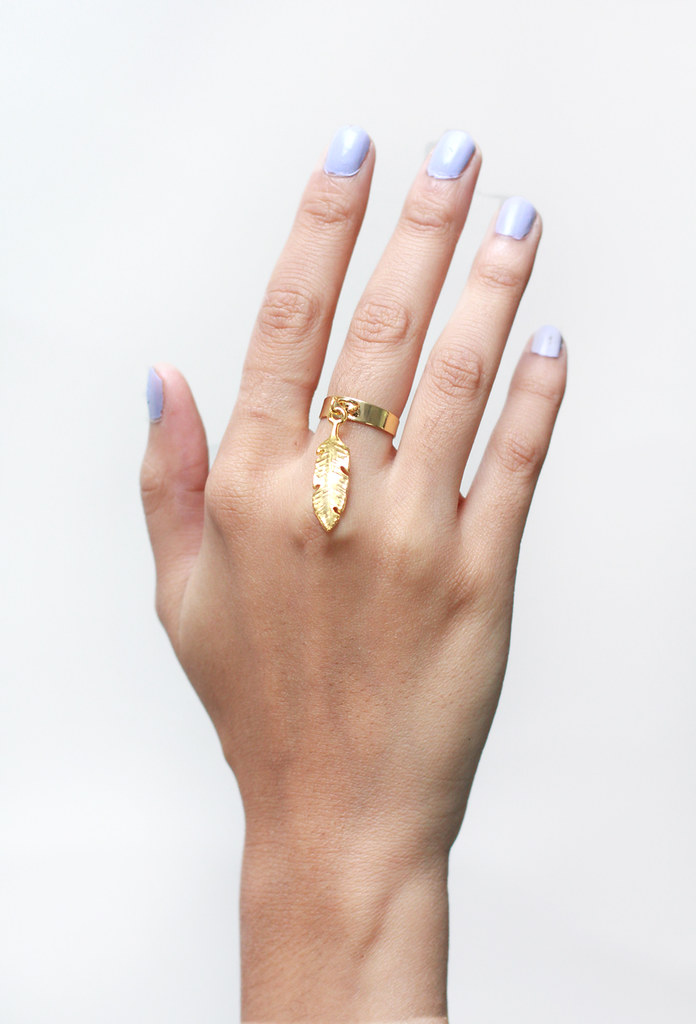 feather charm ring by Tarte Vintage at shoptarte.com