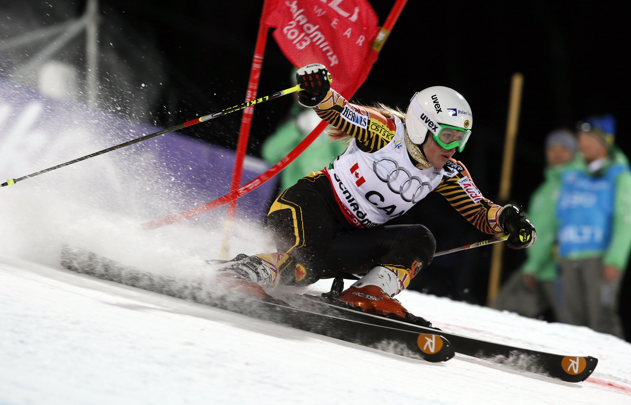 Erin Mielzynski edges out slalom superstar Maria Hoefl-Riesch by one one-hundredth of a second to win her run in the team event at world championships in Schladming, Austria.