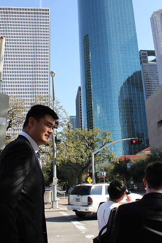 February 15th, 2013 - Yao Ming walks along the streets of downtown Houston