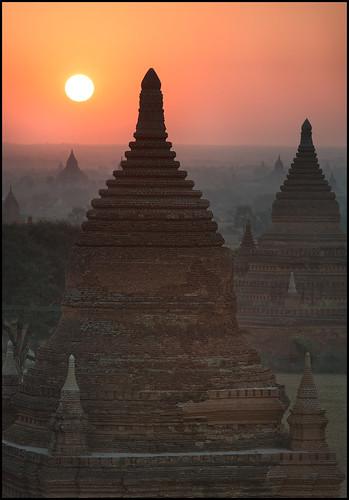 sun fog sunrise landscape religious temple pagoda haze ancient nikon ruins scenery asia southeastasia buddha burma buddhist faith religion ruin scenic buddhism philosophy temples devotion historical myanmar redsky pagan pagodas bagan singhray afs70200mmf28gvrii mandalayregion d800e