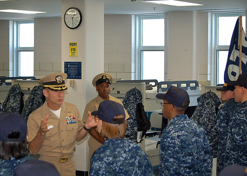Captain Wallace Lovely and his Senior Enlisted Advisor, Senior Chief Eric Stowe, speak to Navy recruits in Division 073